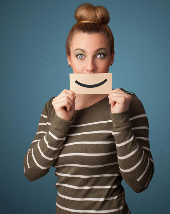 photodune-5630762-happy-pretty-woman-holding-card-with-funny-smiley-m